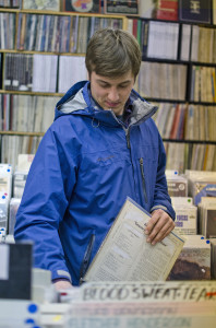 Customer Alex Kleim selects a record at Jerry's. Photo by Alyssa Kramer