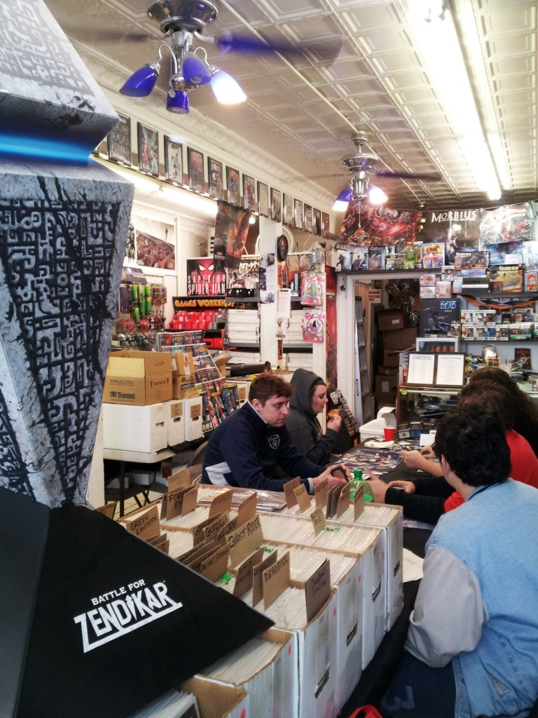 """A group of people play """"Magic: The Gathering"""" inside Geekadrome. Photo by Grant Stoner."""