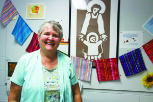 Sister Vanderneck stands in front of a picture of St. Joseph, for whom the organization is named. Photo by Claire Murray.