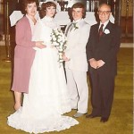 The bride's parents, Annanina and Joseph Colonna, are pictured with the married couple. Photo courtesy of Lisa Healy.