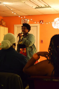 Jacquea Mae sings at an open mic night.