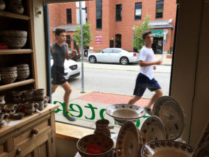 Photo by Dan Priore Joggers pass by the Irish Design Center.