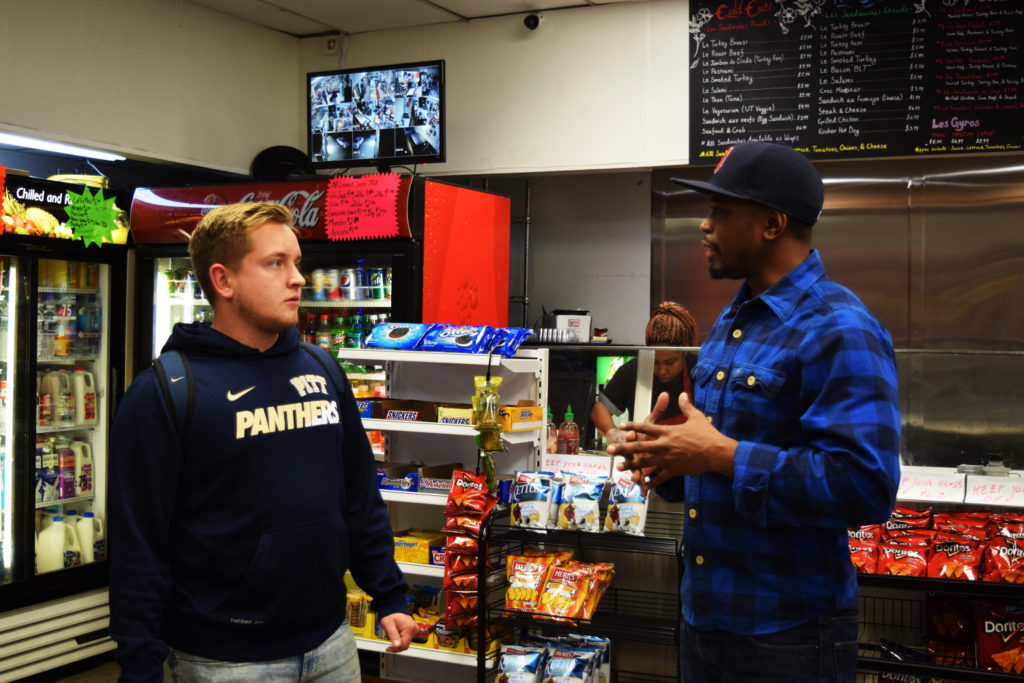 Frenchi chats with customer and University of Pittsburgh student Paul Williams. Frenchi is famous among Pitt's student body.