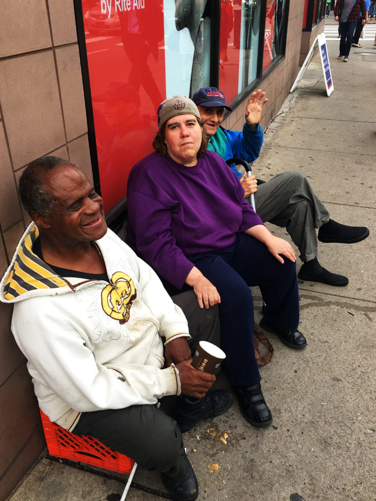 (Front to back) Bill, Jenny and John sit out in front of the Forbes Avenue Rite Aid in Oakland, hoping for some spare change from passersby.