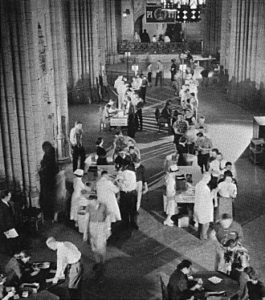 Public Domain Photo Salk and his team administer the polio vaccine to patients on February 26, 1957, in the Commons Room of the University of Pittsburgh's Cathedral of Learning.