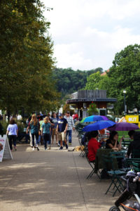 Colorful umbrellas dot Schenley Plaza's open-air eating areas as the skies open up.